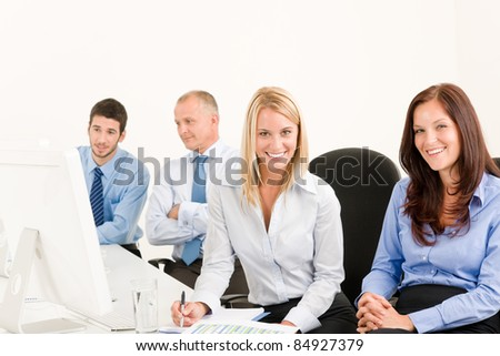 Business team attractive woman sit in line behind computer table