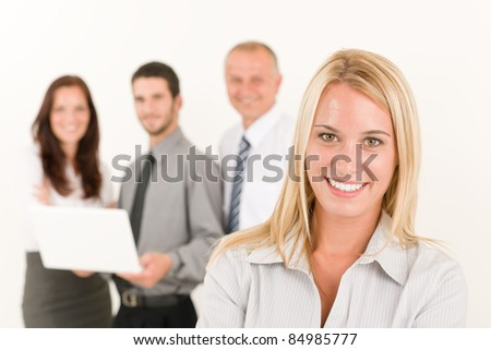 Business team attractive woman with colleagues posing in the back - stock photo