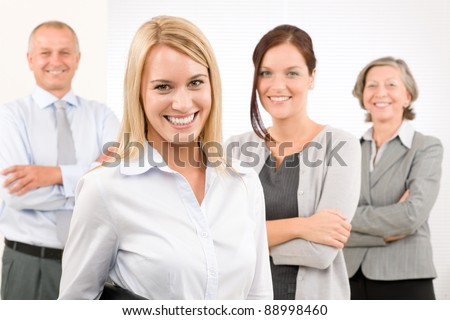 Business team attractive young businesswoman with happy mature colleagues