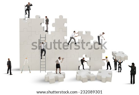 Business team Builds a new company with puzzle - stock photo