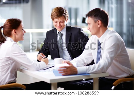 Business team bursting out laughing while holding a discussion