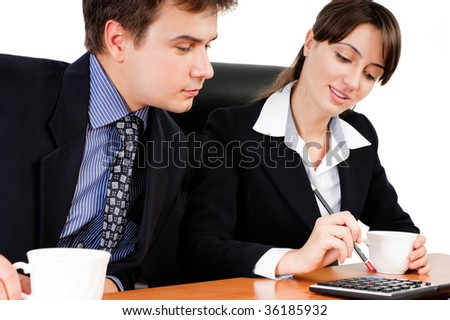 Business team calculating at a meeting against white background - stock photo