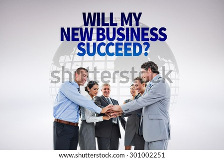 Business team celebrating a good job against grey background - stock photo