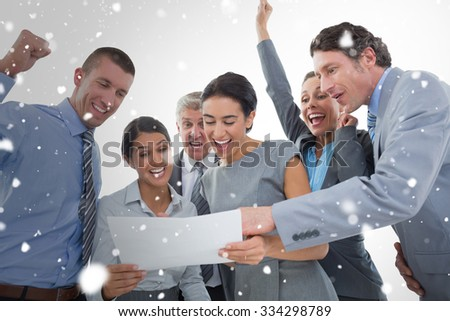 Business team celebrating a new contract against snow - stock photo