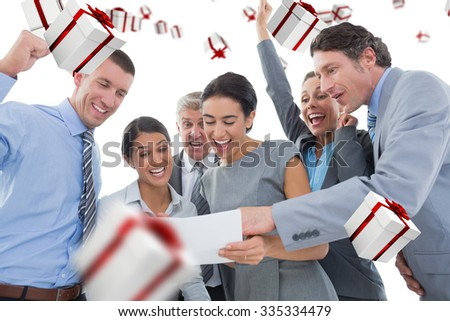 Business team celebrating a new contract against white and red gift box - stock photo
