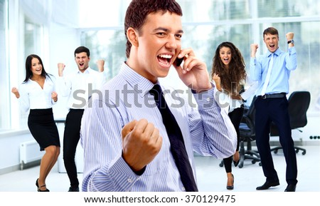 Business team celebrating a triumph with arms up - stock photo