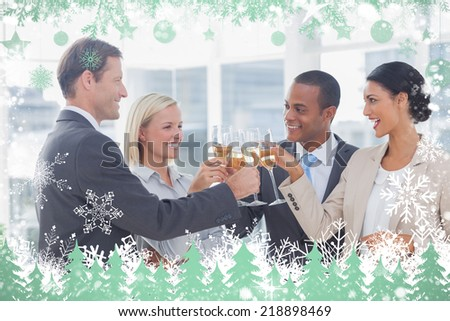 Business team celebrating with champagne and toasting against snow - stock photo
