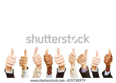 Business team celebrating with their thumbs up - stock photo