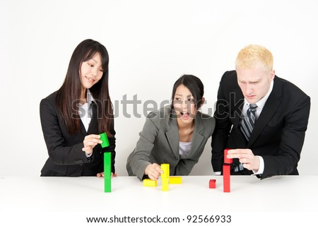 business team competing to make building - stock photo