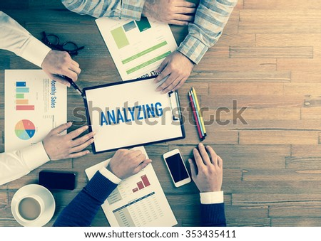Business Team Concept: ANALYZING - stock photo