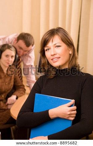 Business team consistent of caucasian men and women at work place