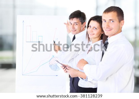 Business team discussing a project - stock photo