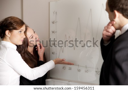 Business team discussing about diagram  - stock photo
