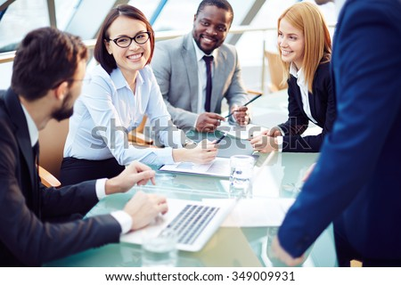 Business team discussing together business plans - stock photo