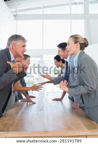 Business team discussing together in the office - stock photo