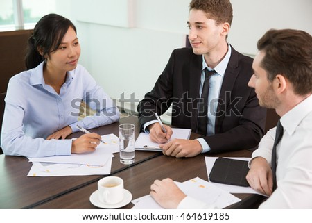 Business Team Discussion at Meeting in Office