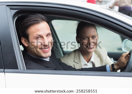 Business team driving somewhere in the car