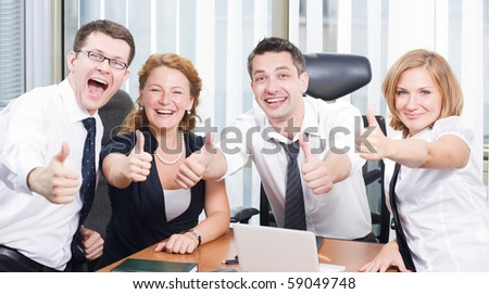 Business team express positivity on meeting in board room - stock photo