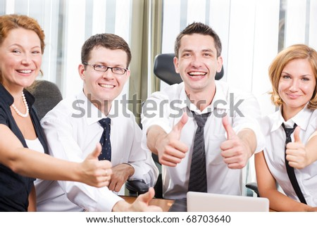 Business team express positivity on meeting in board room in Hi Res - stock photo