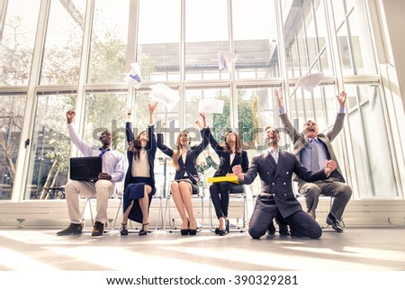 Business team exulting - Happy cheerful businessmen rising arms and throwing documents, concepts about success and teamwork - stock photo