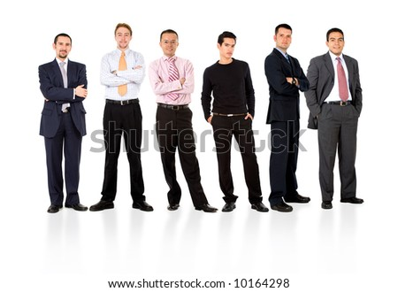business team formed of young businessmen standing over a white background with reflections - stock photo