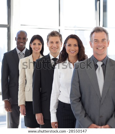 business team from different cultures looking at camera - stock photo