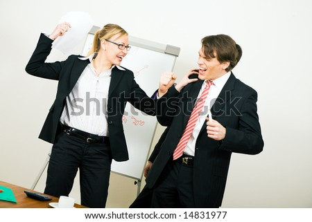 Business Team having a - friendly! - conflict - stock photo