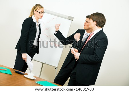 Business Team having a rather serious argument - stock photo