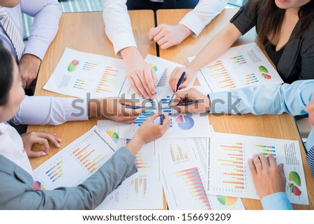 Business team having briefing viewed below - stock photo