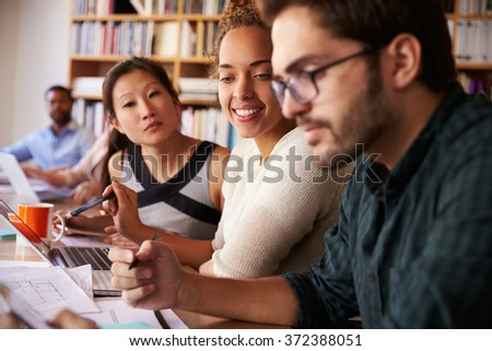 Business Team Having Meeting In Busy Office - stock photo