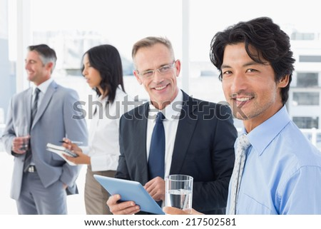 Business team having some drinks while working - stock photo