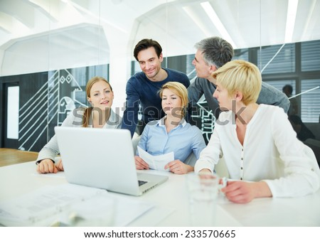 Business team having training at computer in the office - stock photo