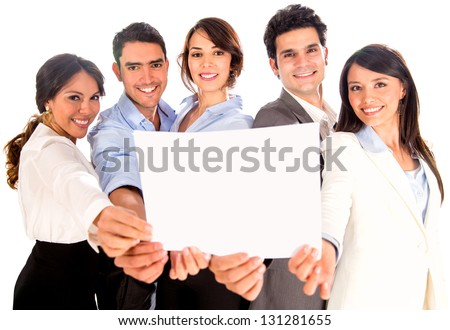 Business team holding a banner or document - isolated over white - stock photo