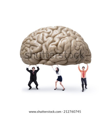 Business team holding a brain, symbolizing a big idea or creativity - stock photo