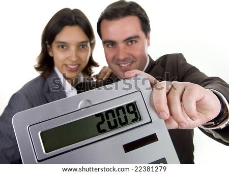 business team holding a calculator - new year resolution - 2009 - stock photo