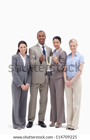 Business team holding a cup against white background - stock photo