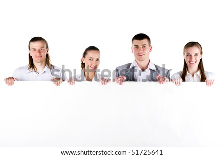 Business team holding a large blank sign on white background - stock photo