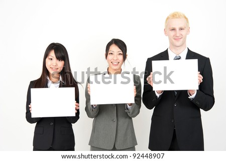 business team holding a whiteboard isolated on white background - stock photo