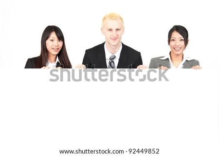 business team holding big whiteboard isolated on white background - stock photo