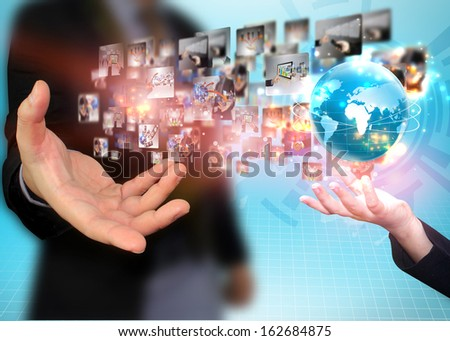 Business team holding business world - stock photo