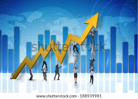 Business team holding up arrow against global business graphic in blue - stock photo