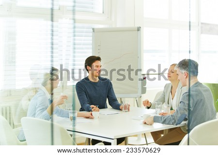 Business team in a consulting meeting in the office - stock photo