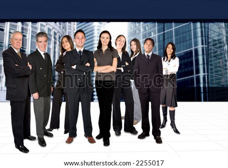 business team in a corporate environment with buildings at the background - stock photo