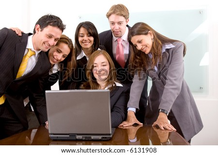 business team in an office laptop computer - meeting