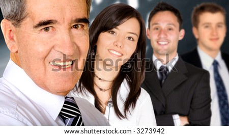 Business team in an office lead by a businessman - stock photo