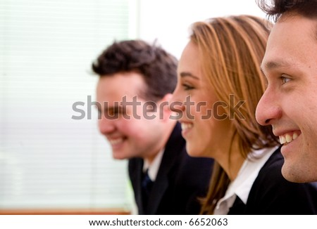 business team in an office profile where all are smiling - stock photo