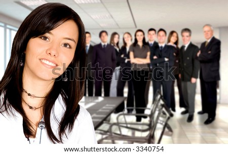 Business team in an office with a businesswoman leading - stock photo