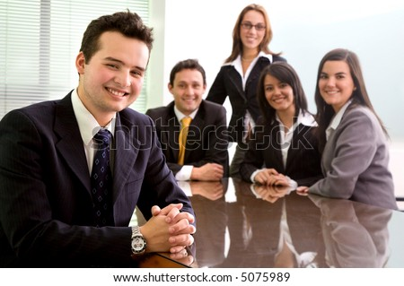 Business team in an office with a man leading