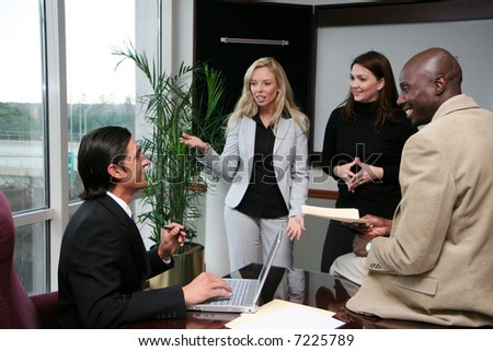 Business Team in an office working together - stock photo