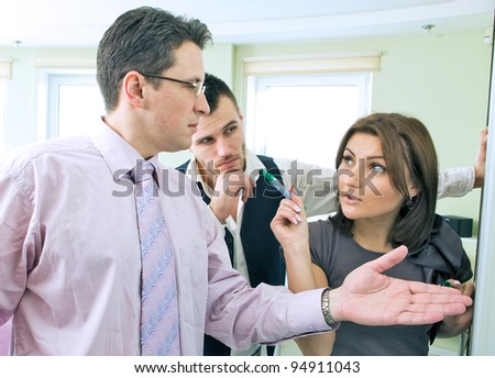 Business team in discussion working together in board room - stock photo